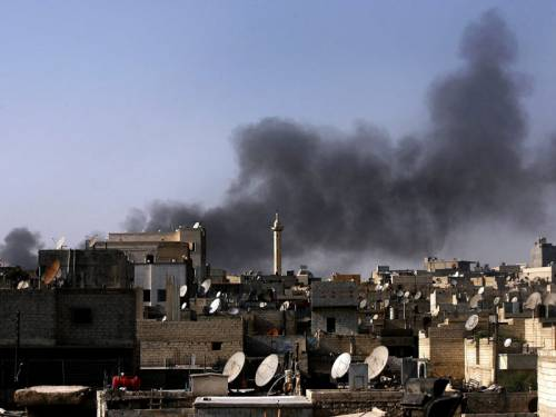 A fighter jet has bombed an apartment building in eastern Syria, killing at least 21 people. (AAP)