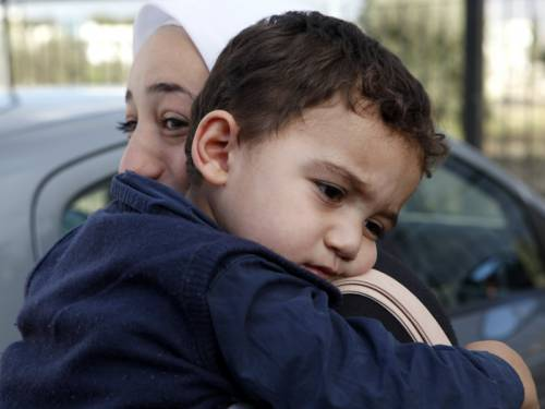 A two-year-old boy accidentally left behind in war torn Syria has been reunited with his family. (AAP)