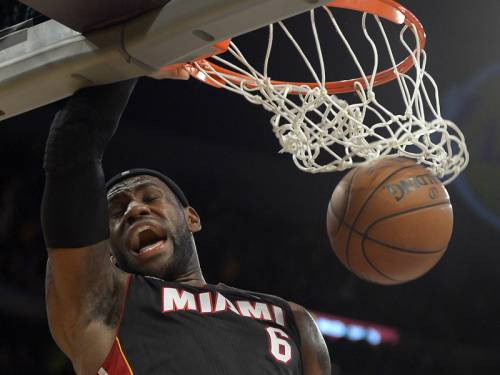 LeBron James has scored 39 points to lead Miami Heat to a 99-90 win over the LA Lakers. (AAP)