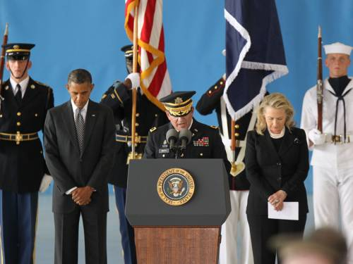 Barack Obama and Hillary Clinton have paid respects to those killed in the US consulate in Libya. (AAP)