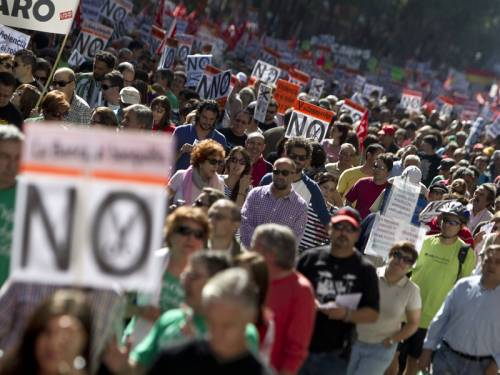 Tens of thousands of people have marched in Spain in protest of planned austerity measures. (AAP)