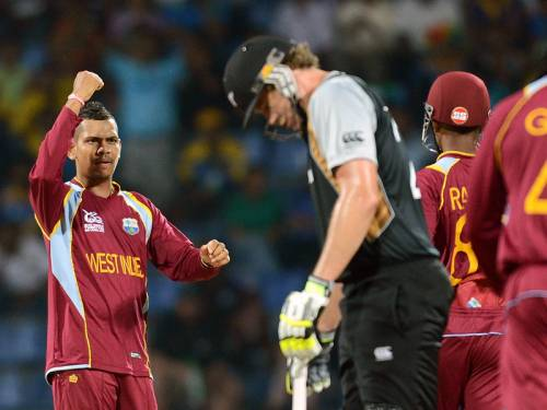 The West Indies knocked New Zealand out of the World T20 with a dramatic Super Over win in Kandy. (AAP)