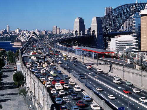 Cars approaching the Sydney Harbour Bridge from North Sydney. (AAP)
