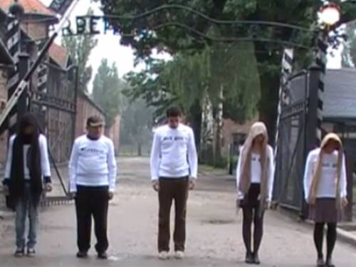 Melbourne artist Jane Korman dances outside Auschwitz with her family in her controversial YouTube film.