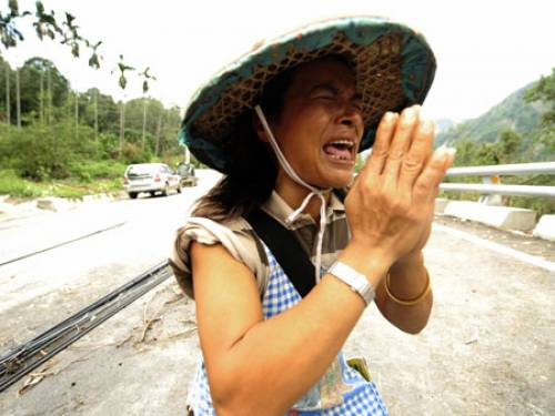 A woman mourns loved-ones killed in typhoons in Taiwan in 2009. (Getty)