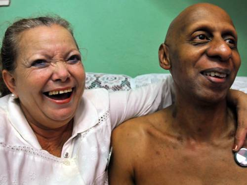 Cuban dissident Guillermo Farinas, right, smiles with Laura Pollan, left, member of 'Las Damas de Blanco' organisation at Farinas' home in Santa Clara, Cuba (EPA).