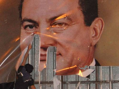 Mubarak's image being defaced during the early days of the revolution. (AP)