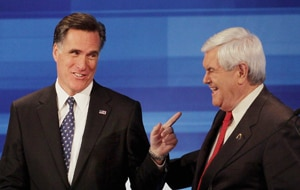 Romney jests with Gingrich during a recent televised debate. (AFP)