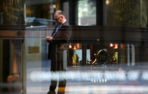 A man stops outside the Commonwealth Bank in Sydney's CBD. (AAP)