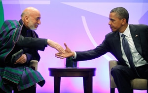 President of Afghanistan Hamid Karzai shakes hands with US President Barack Obama. (AAP)