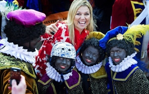 Princess Maxima poses with zwarte Pieten (Black Petes) during the arrival of Sinterklaas, or Santas Claus. (AAP)