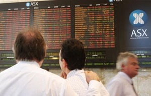The Aussie dollar was boosted by news of a merger between the ASX and Singapore Exchange but will that be enough to stave off an interest rate rise by the RBA next week?(AAP)