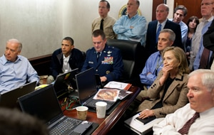 The inner circle, including Hilary Clinton, watch the Navy SEAL raid from the Situation Room. (A))