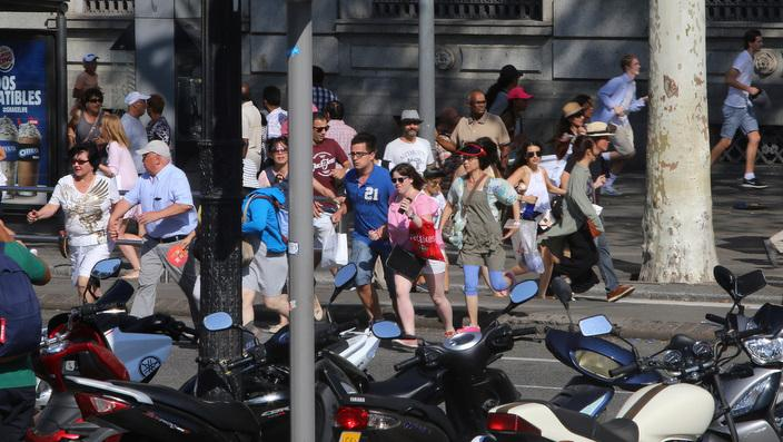 People flee the scene in Barcelona, Spain, after a white van ploughed into pedestrians in the historic Las Ramblas district