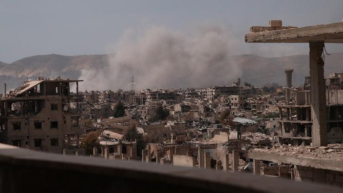 Smoke billows from a reported air strike in Damascus