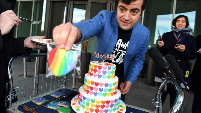 Labor Senator Sam Dastyari with his Marriage Equality Cake at the Senate doors at Parliament House in Canberra