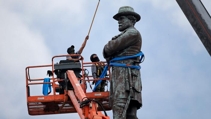 Workers prepare to take down the statue of former Confederate general Robert E. Lee, which stands over 100 feet tall, in Lee Circle in New Orleans