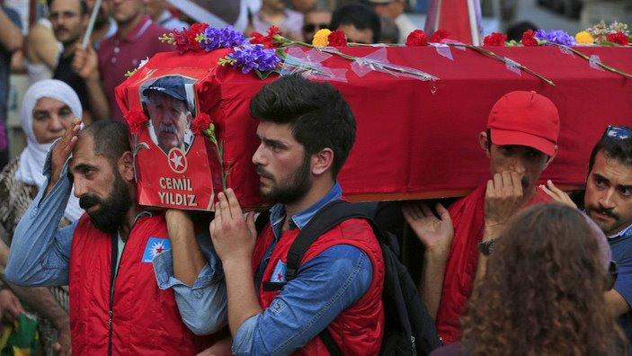 Mourners carry the coffin of Cemil Yildiz, one of the victims of an explosion in the town of Suruc, Turkey (AP Photo/Lefteris Pitarakis)