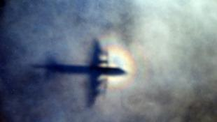 Shadow of a plane searchng Indian Ocean in 2014 (AAP)