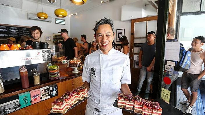 Black Star Pastry, Newtown, Sydney. Chris holds slices of his famous strawberry watermelon cake.(supplied by city of sydney)