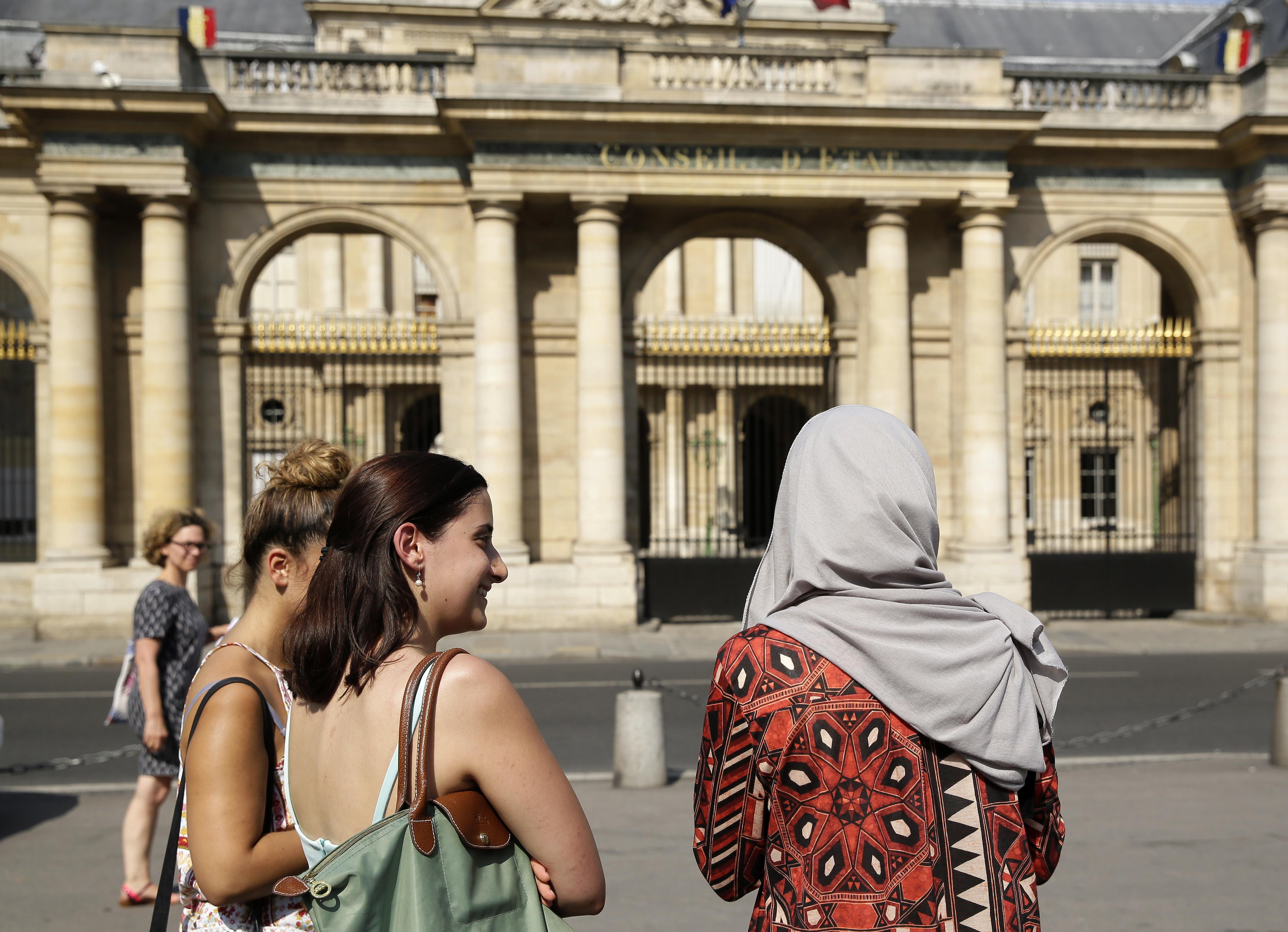 Women talking outside France's top administrative court (AAP)