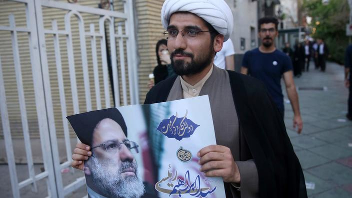 A clergyman shows his support for Ebrahim Raisi