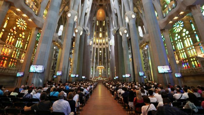 People attend a memorial mass at the Sagrada Familia Cathedral in Barcelona, Spain