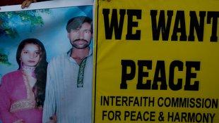 Human rights activists hold a picture of the couple  during a demonstration in Karachi, Pakistan.