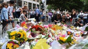 Thousands of Sydneysiders lay flowers near the Lindt chocolate cafe in Martin Place