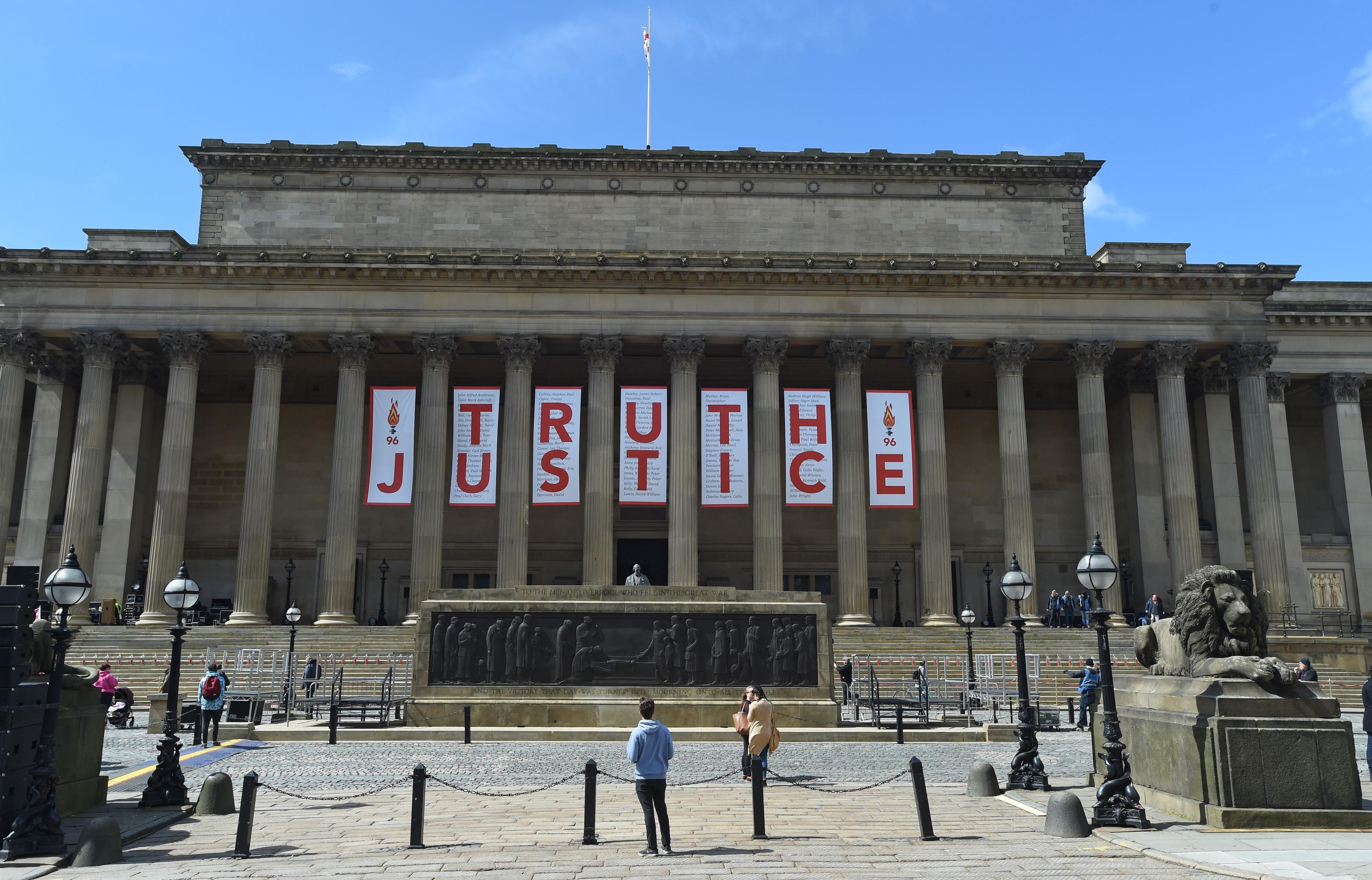 A giant banner is unveiled at St George's Hall in Liverpool after the inquest ruling
