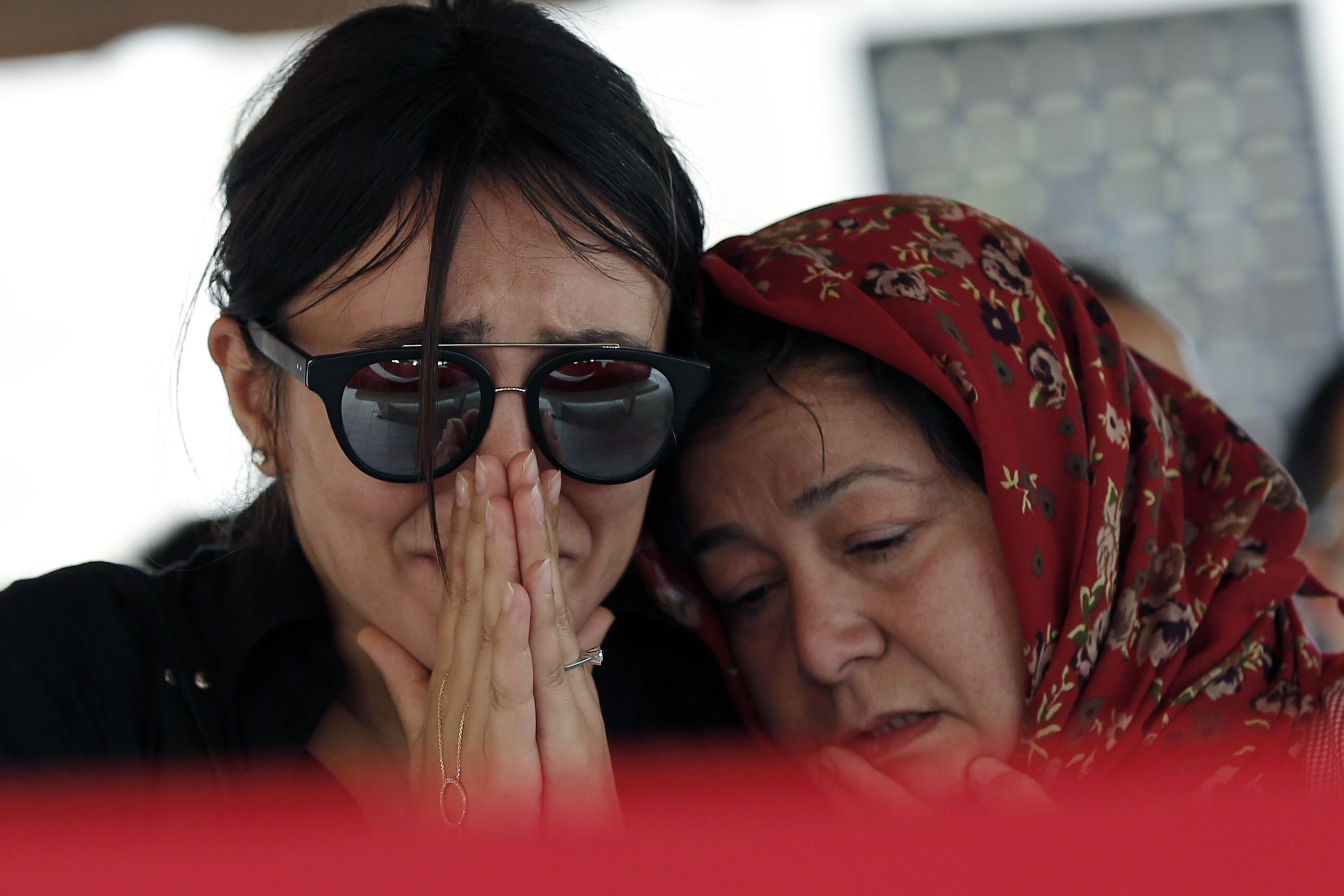 Mourners at the funeral for Gulsen Bahadir