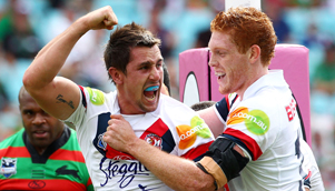 Mitchell Pearce, left, has scored four tries in two games for the Roosters this season [GETTY]