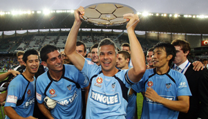Sydney FC captain Steve Corica holds the Premier's Plate aloft, but are the Sky Blues the true champions? [GETTY]