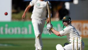 That's out... Philip Hughes watches his ill-advised slash outside off stump fly to first slip [GETTY]