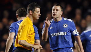 Chelsea captain John Terry threatens to run referee Wolfgang Stark down in the car park. Sort of. [GETTY]