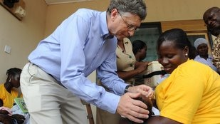Microsoft founder Bill Gates gives a Ghanaian child a rotavirus vaccination